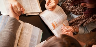 10476-women-bow-and-pray-over-bibles_edited-630w-tn
